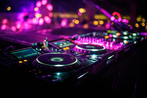 DJ console desk at nightclub DJ console desk at nightclub nightclub stock pictures, royalty-free photos & images