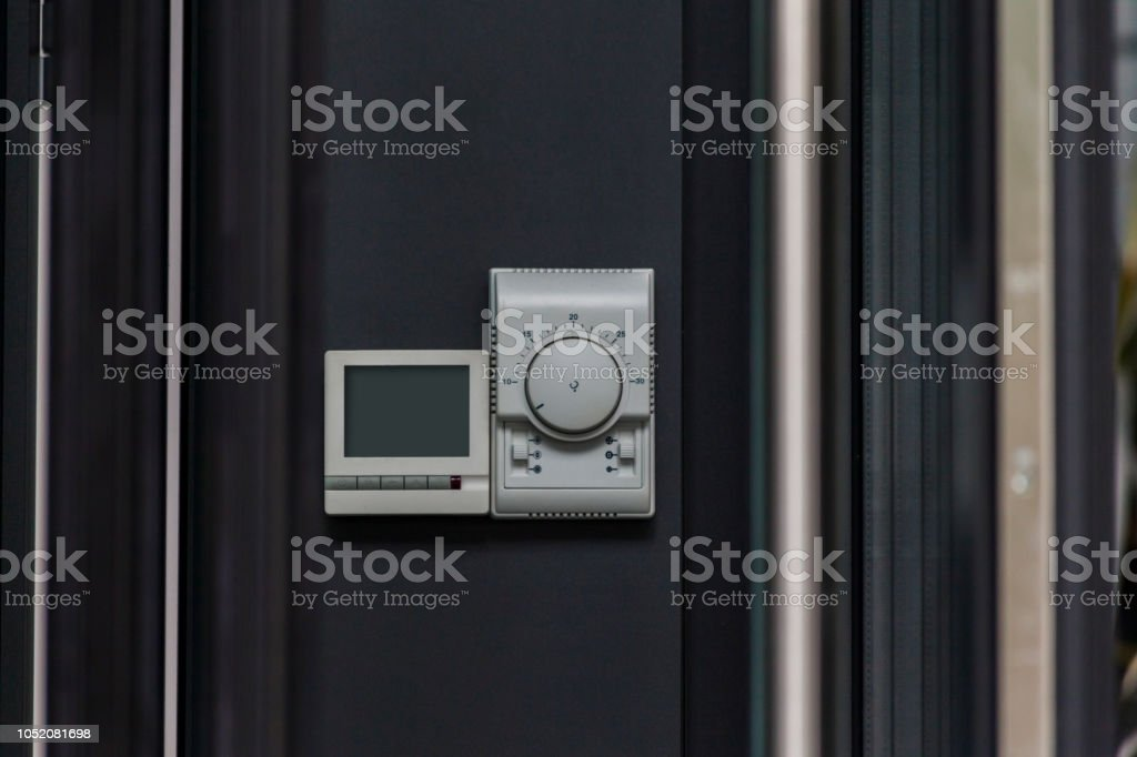 console for controlling heating and cooling on the wall
