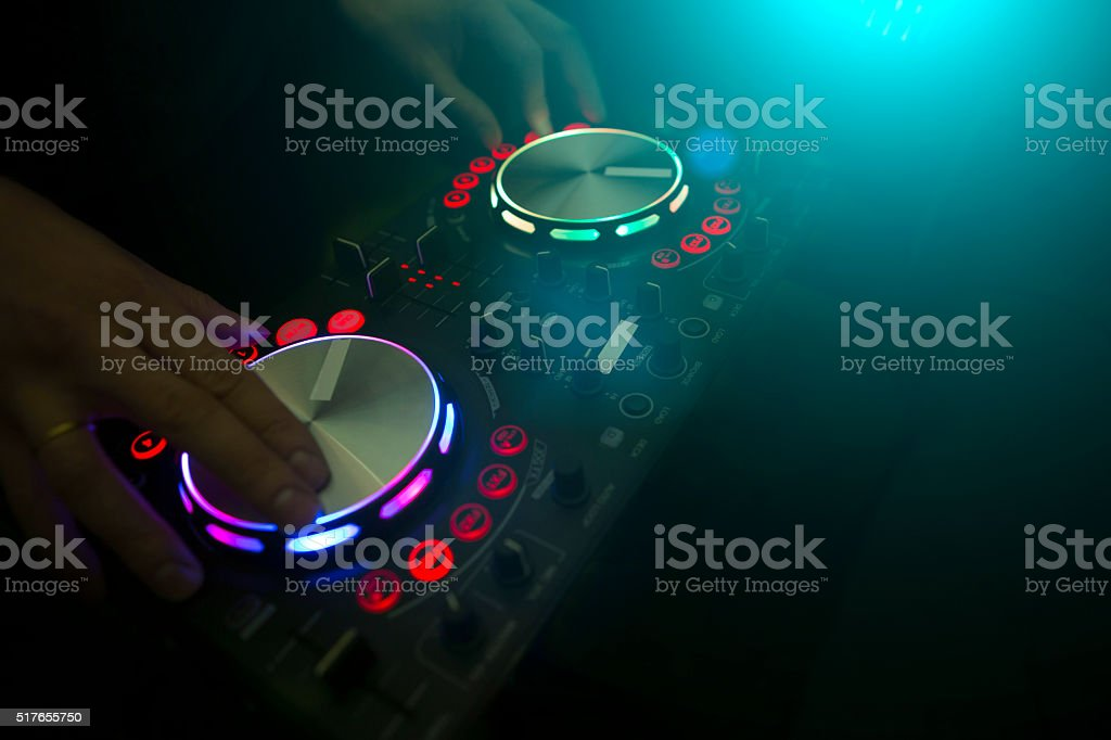 DJ console mixer controlling with two hand stock photo