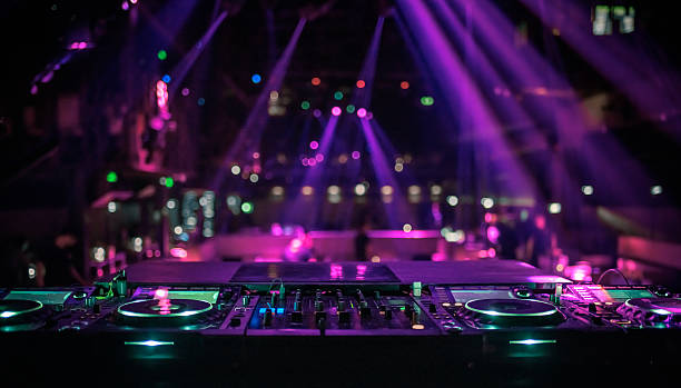 dj console mixing desk at a night club - nightclub stock photos and pictures