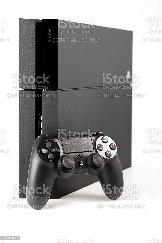 Console Playstation 4 and pad Dualshock on white background stock photo
