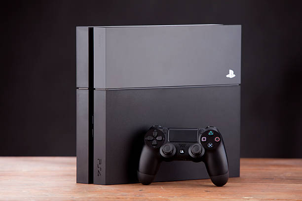 console playstation 4 and pad dualshock on white background - playstation stockfoto's en -beelden