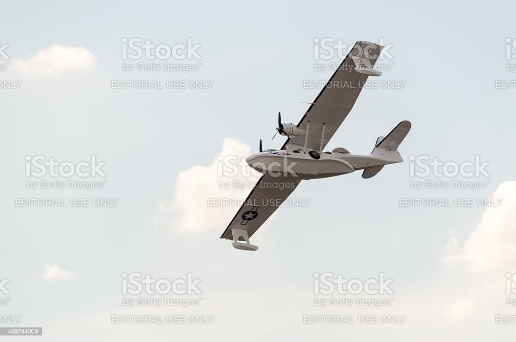 Consolidated PBY Catalina flying boat flies against cloudy sky background. royalty-free stock photo