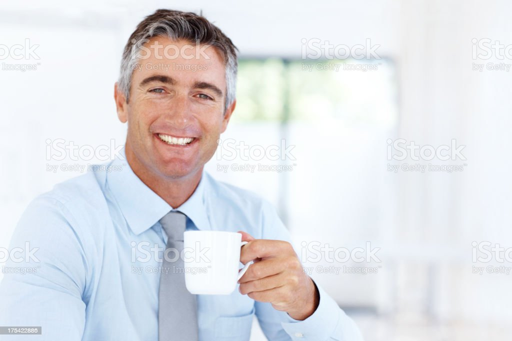 Consolidating with a cup of coffee - Enterprising executives royalty-free stock photo
