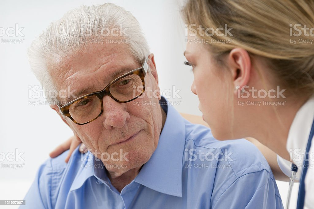 Consoling elder man stock photo
