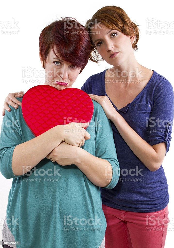 Consoling friends suffering from a broken heart royalty-free stock photo