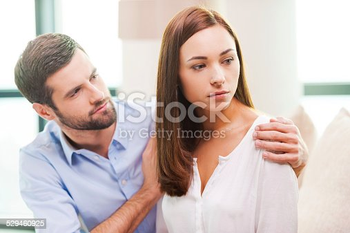 468456828istockphoto Consoling his depressed girlfriend. 529460925