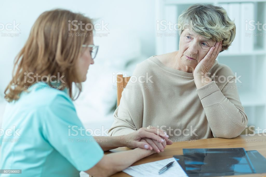 Consoling old patient stock photo