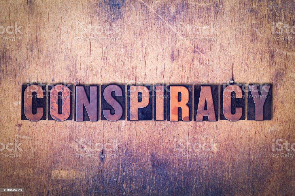 Conspiracy Theme Letterpress Word on Wood Background stock photo
