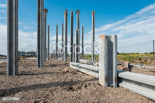 consruction site with  precast concret pile and pile-driver, prefabrication house structure design
