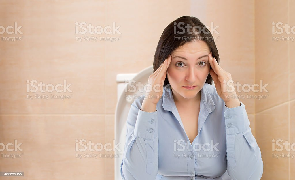 constipated woman stock photo