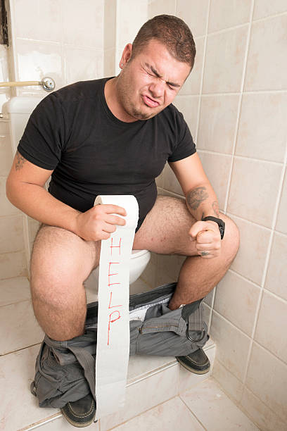 Constipation Man suffering digestive system problem. anhydrous stock pictures, royalty-free photos & images