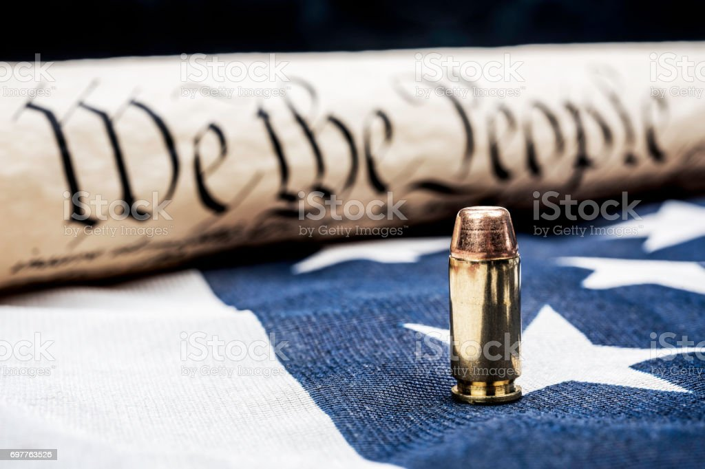 Constitution and bullet stock photo