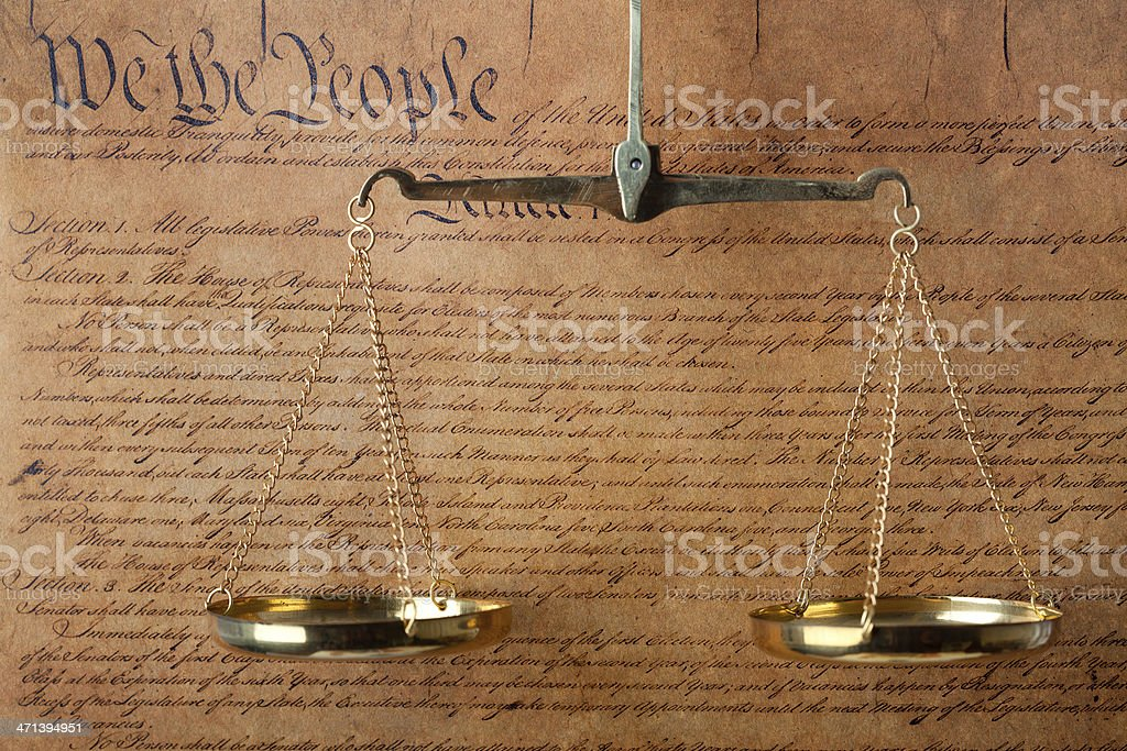 USA Constitution document and scales of justice stock photo