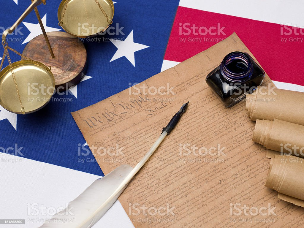 US constitution documents and scales of justice on american flag royalty-free stock photo