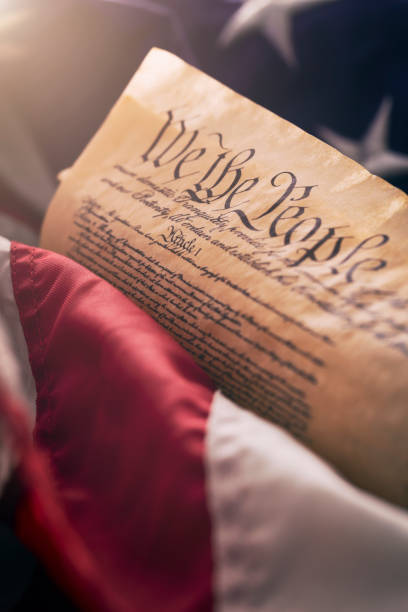 usa -  constitution of the united states of america and flag - mphillips007 stock pictures, royalty-free photos & images