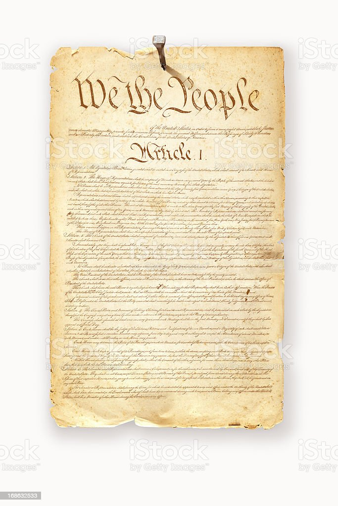 Constitution USA fixed with nail on white background royalty-free stock photo