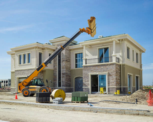 constructing quality homes - land vehicle stock photos and pictures