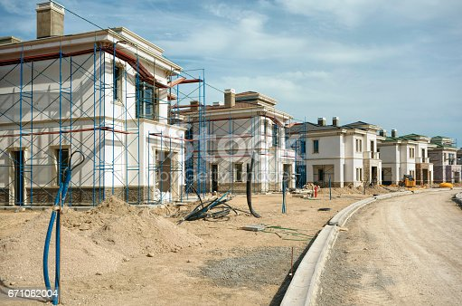 exterior shot of a construction site of a town house