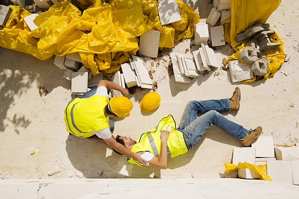 Construction accident while working on site Construction worker has an accident while working on new house misfortune stock pictures, royalty-free photos & images