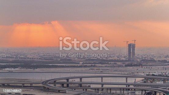 512697874 istock photo Construction and intersection near Dubai Creek Harbor aerial timelapse during sunrise. Dubai - UAE 1235246842