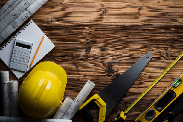 Construction and renovation concept. Contractor tools, on wooden table. Top view shot. general military rank stock pictures, royalty-free photos & images