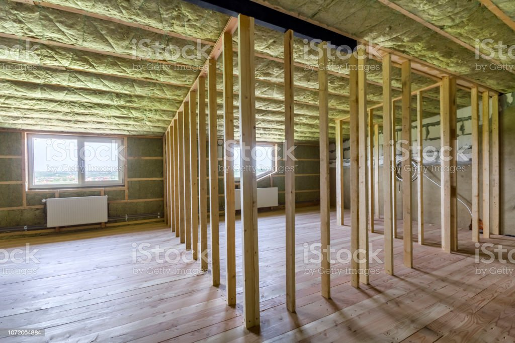 Construction and renovation of big light spacious empty room with oak...