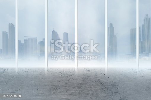 istock construction, architecture and building concept - airport terminal empty room over blue sky and clouds background 1077224918