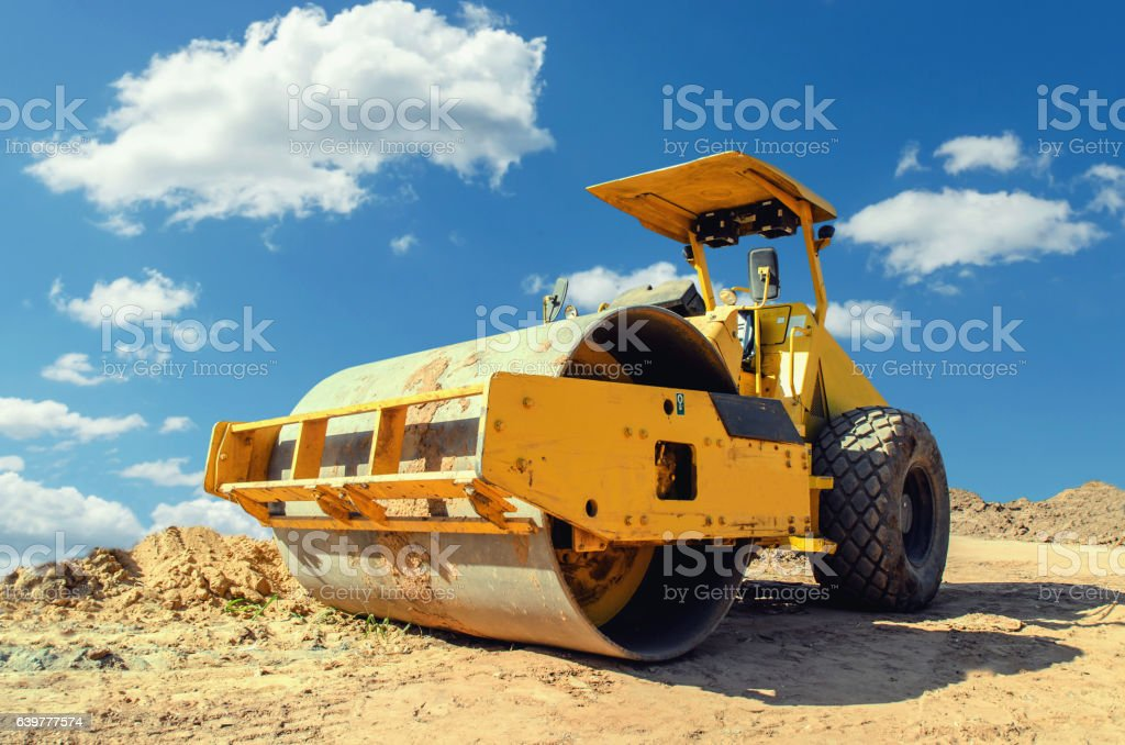 Construction asphalt roller closeup and blue sky background stock photo