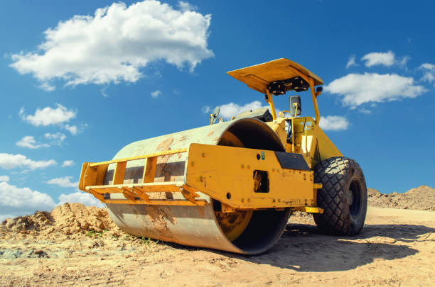 Construction asphalt roller closeup and blue sky background Construction asphalt roller closeup and blue sky background compactor stock pictures, royalty-free photos & images