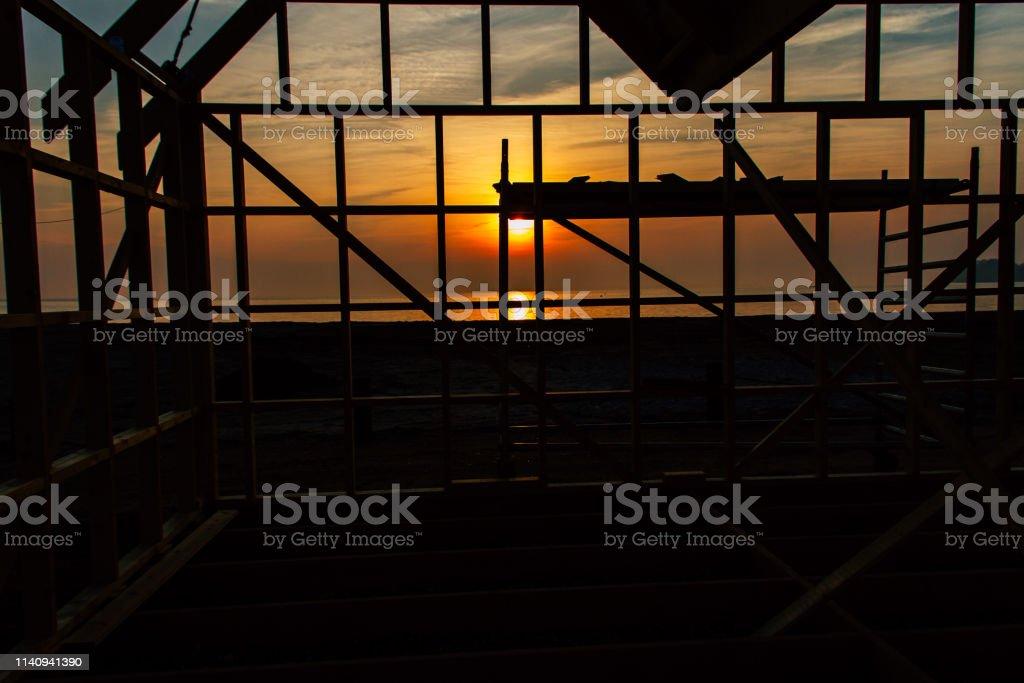 Construction at sunrise stock photo