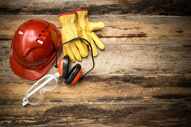 construction background with protective workwear - arbeidsveiligheid stockfoto's en -beelden