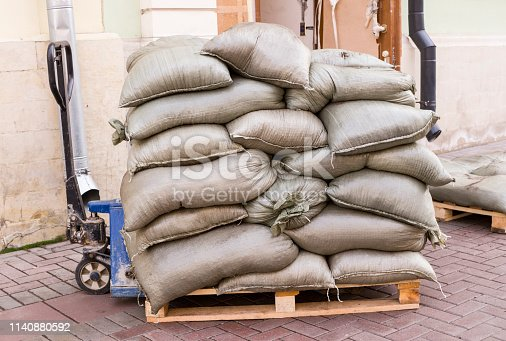 istock construction bags on the pallets with loader. industrial, building. 1140880592