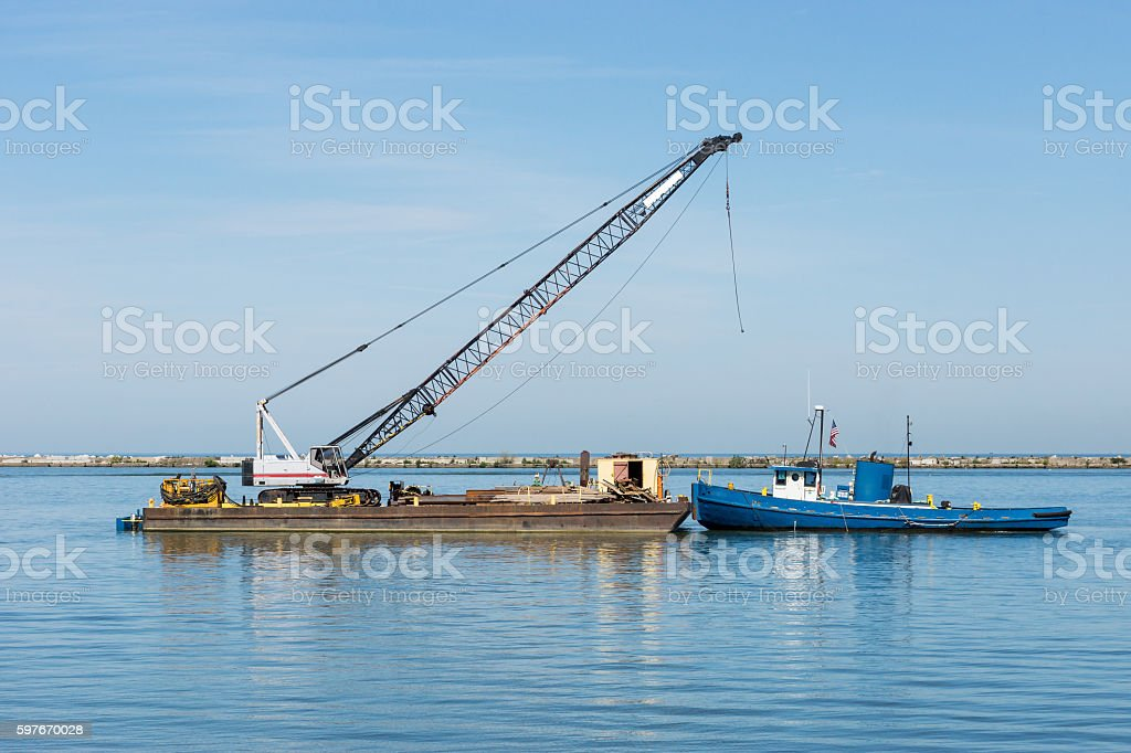 Construction Barge And Tugboat stock photo
