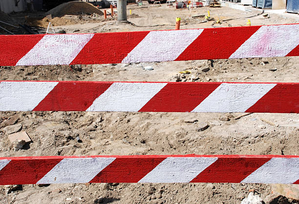 construction barrier - palisade boundary stock photos and pictures