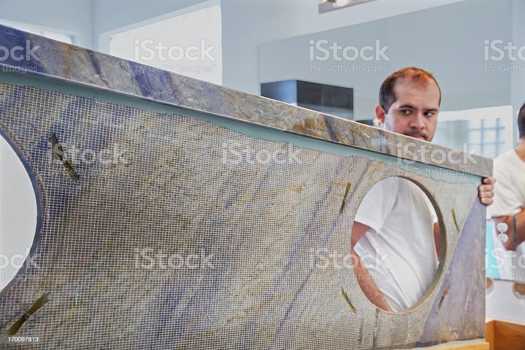 Construction: Bathroom renovation installing granite royalty-free stock photo
