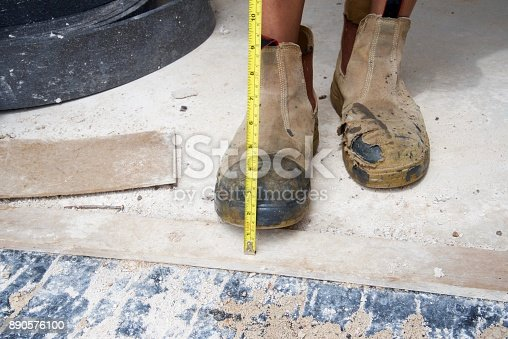 istock SYD112017 Construction boots and measuring tape 890576100