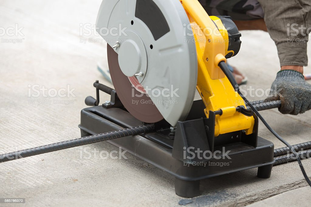 Construction builder worker with grinder machine cutting metal r stock photo