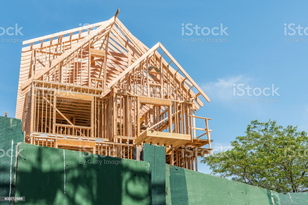 Construction building new modern unfinished townhouses or house with wooden frame and nobody stock photo