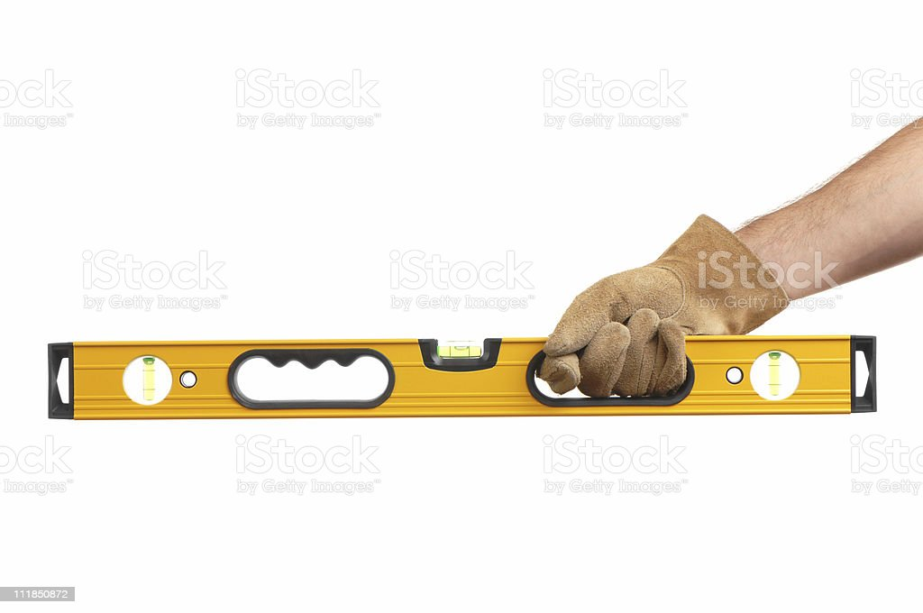 Construction Carpenter Hand in Glove Holding Level on White royalty-free stock photo