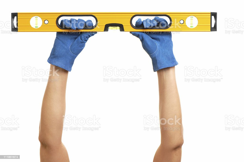 Construction Carpentry Level Held by Woman's Arms on White royalty-free stock photo