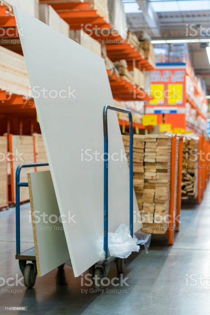 construction cart in the building store. Carts loaded with boards....