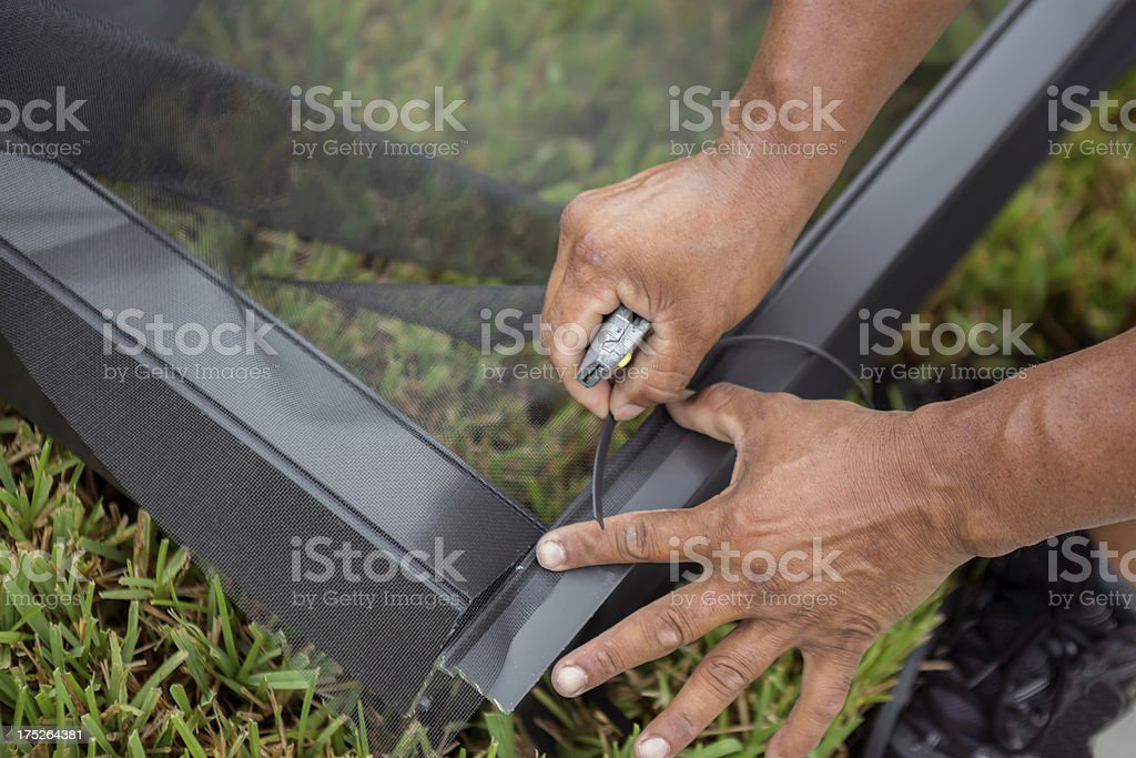 Construction: Closeup of Screen installation series royalty-free stock photo