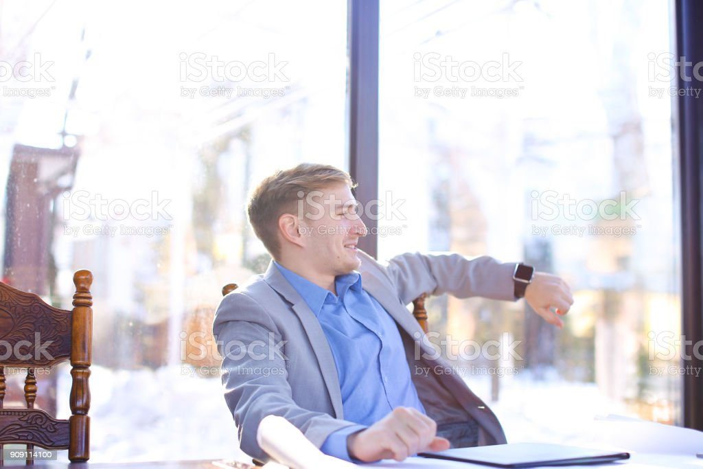 Construction company manager resting at cafe with drafting proje stock photo