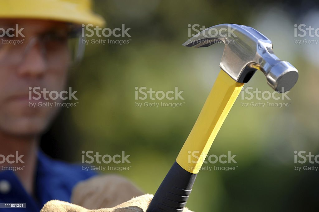Construction Contractor Caprenter Swinging a Hammer royalty-free stock photo