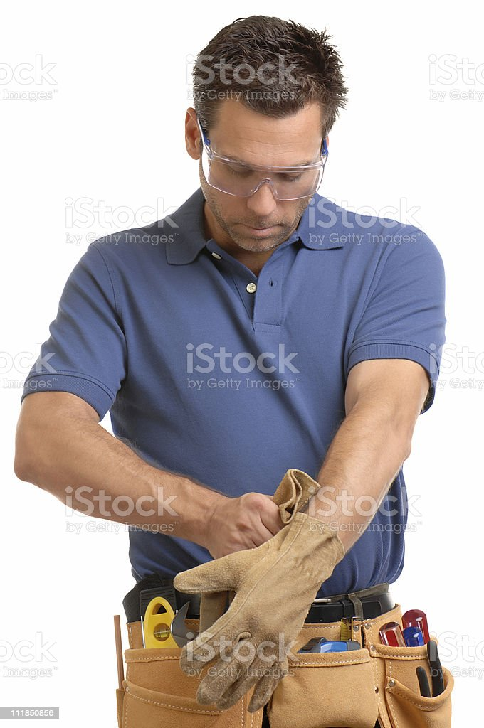 Construction Contractor Carpenter Putting Gloves Isolated on White Background royalty-free stock photo