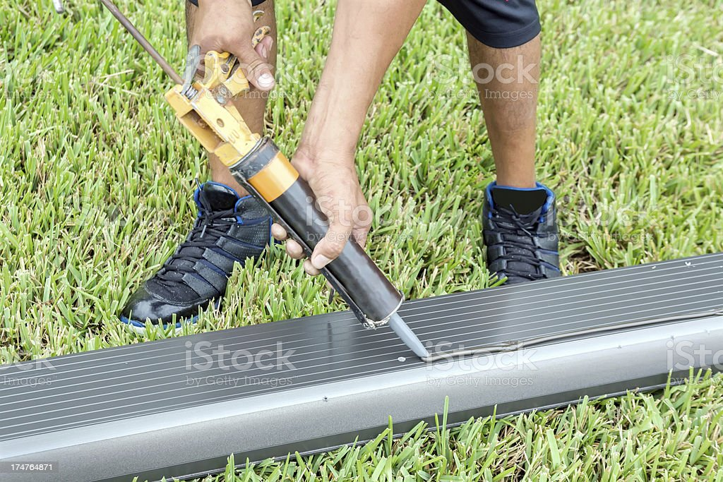 Construction: Contractor installing or replacing a Screen enclosure -Series royalty-free stock photo