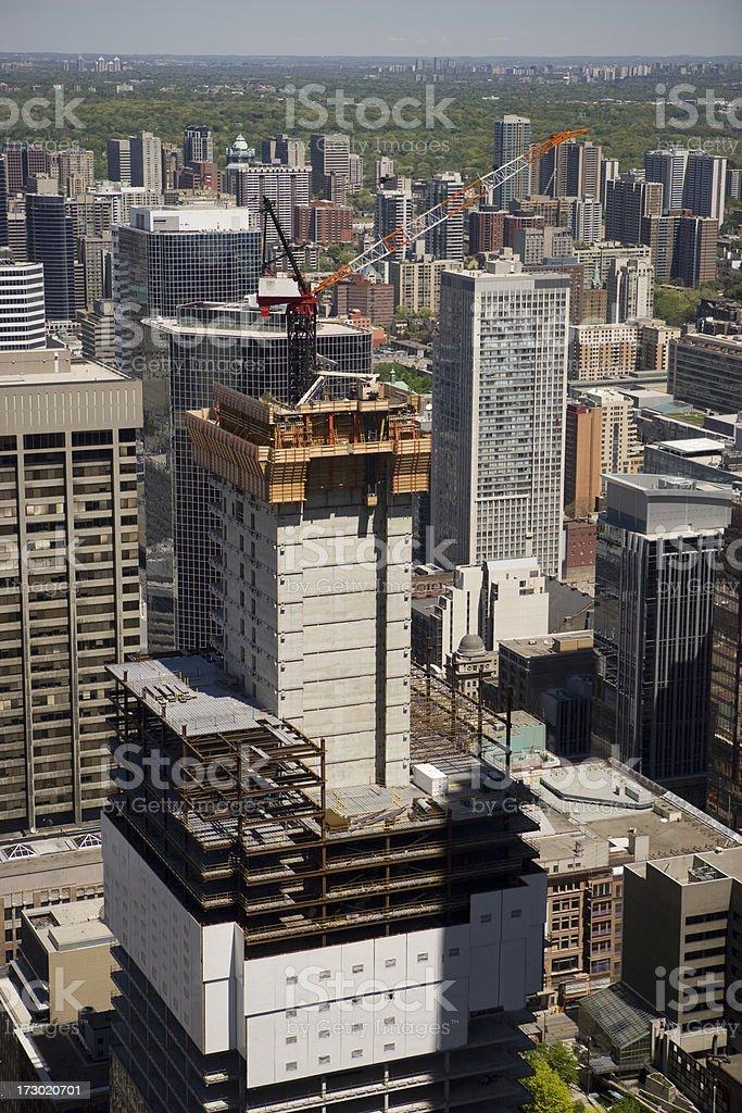 Construction crane atop a building royalty-free stock photo