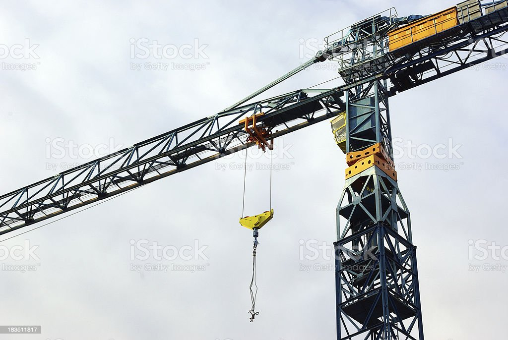 Construction crane hanging overhead stock photo