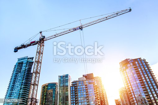 Construction crane in downtown Vancouver at sunrise